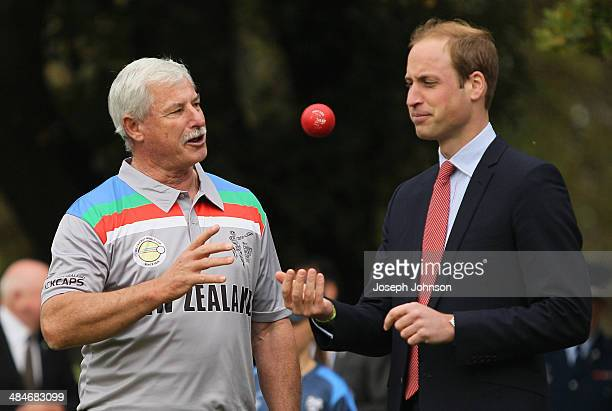 Sir Richard Hadlee ICC Cricket World Cup 2015 Ambassador explains to Prince William Duke of Cambridge how to bowl during a game of cricket during the...