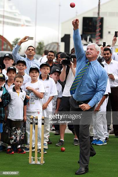 Sir Richard Hadlee rolls his arm over with young cricketers looking on at Queen's Wharf in Auckland for the 2015 Cricket World Cup launch on February...