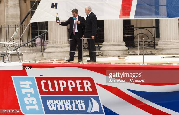 Sir Robin KnoxJohnston and Sport Minister Hugh Robertson after christening the yacht called Great Britain in Trafalgar Square London PRESS...
