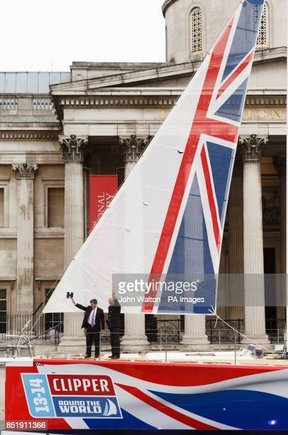 Sir Robin KnoxJohnston and Sport Minister Hugh Robertson christen the yacht called Great Britain in Trafalgar Square London
