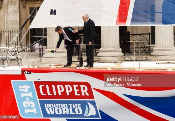 Sir Robin KnoxJohnston and Sport Minister Hugh Robertson prepare to christen the yacht called Great Britain in Trafalgar Square London