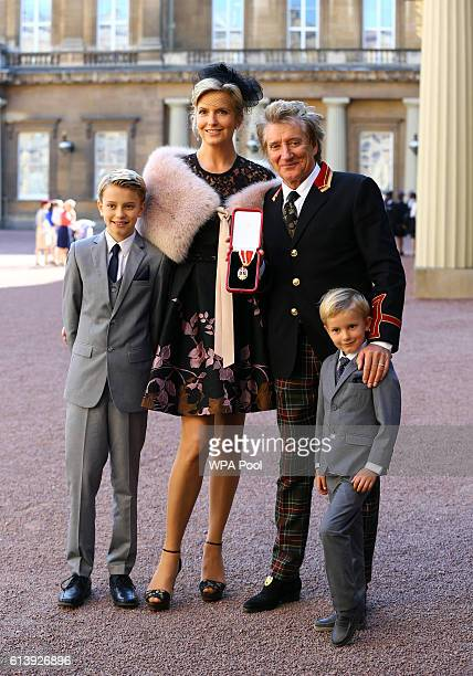 Sir Rod Stewart with his wife Penny Lancaster and children Alastair and Aiden after he received his knighthood in recognition of his services to...