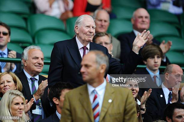 Sir Roger Bannister waves to the crowd as he looks on from the Royal Box prior to the third round match between Caroline Wozniacki of Denmark and...