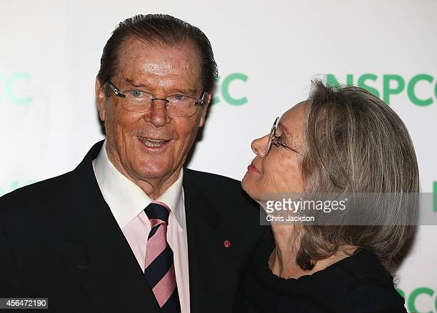Sir Roger Moore and his wife Kristina Tholstrup attend A Night Out With Michael Caine at Royal Albert Hall on October 1 2014 in London England