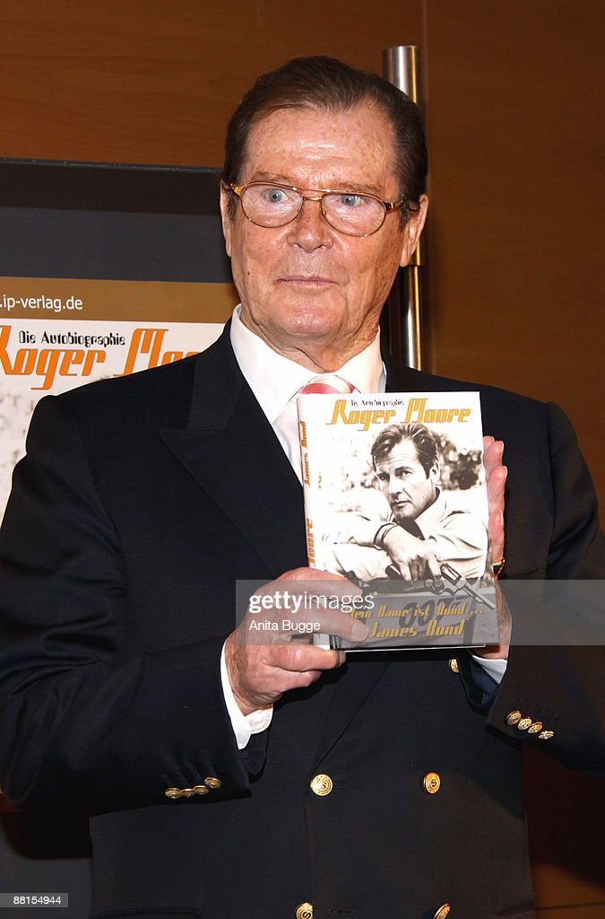 Sir Roger Moore presents the Germanlanguage edition of his new autobiography 'My Word Is My Bond' during a book signing at Dussmann bookstore on June...