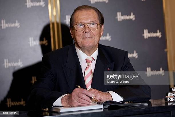 Sir Roger Moore signs copies of his new book 'Bond On Bond' at Harrods on October 11 2012 in London England