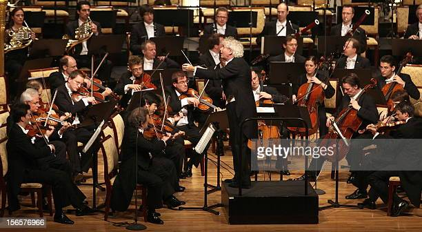 Sir Simon Rattle conducts the Berlin Philharmonic Orchestra during a concert in Abu Dhabi late November 10 2010 The Concert in Abu Dhabi marks the...