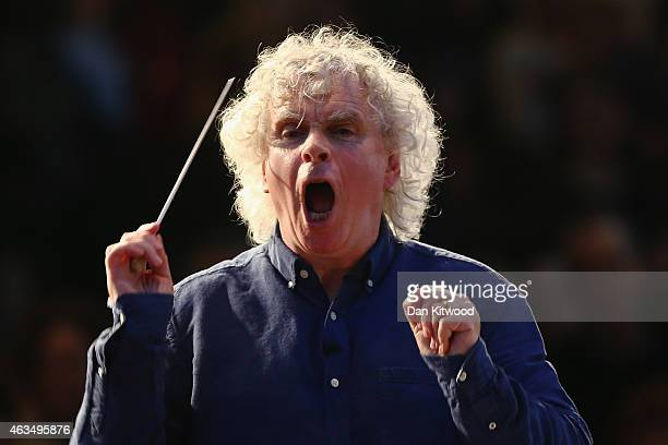 Sir Simon Rattle leads the 100 piece 'Young Orchestra for London' at London's South Bank on February 15 2015 in London England The 'Young Orchestra...