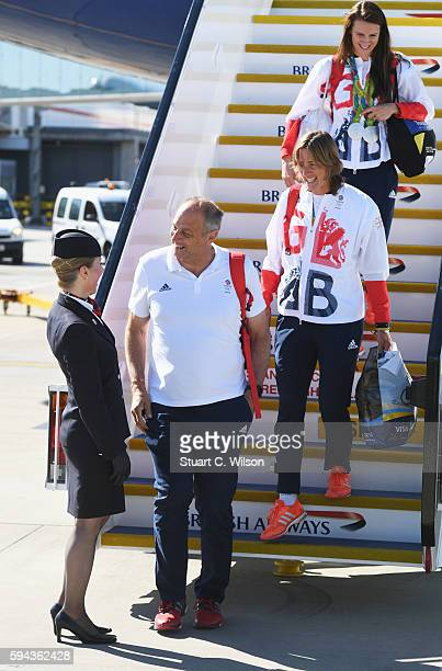 Sir Steve Redgrave and fellow rower and silver medallist Katherine Grainger arrive home at Heathrow Airport on August 23 2016 in London England The...