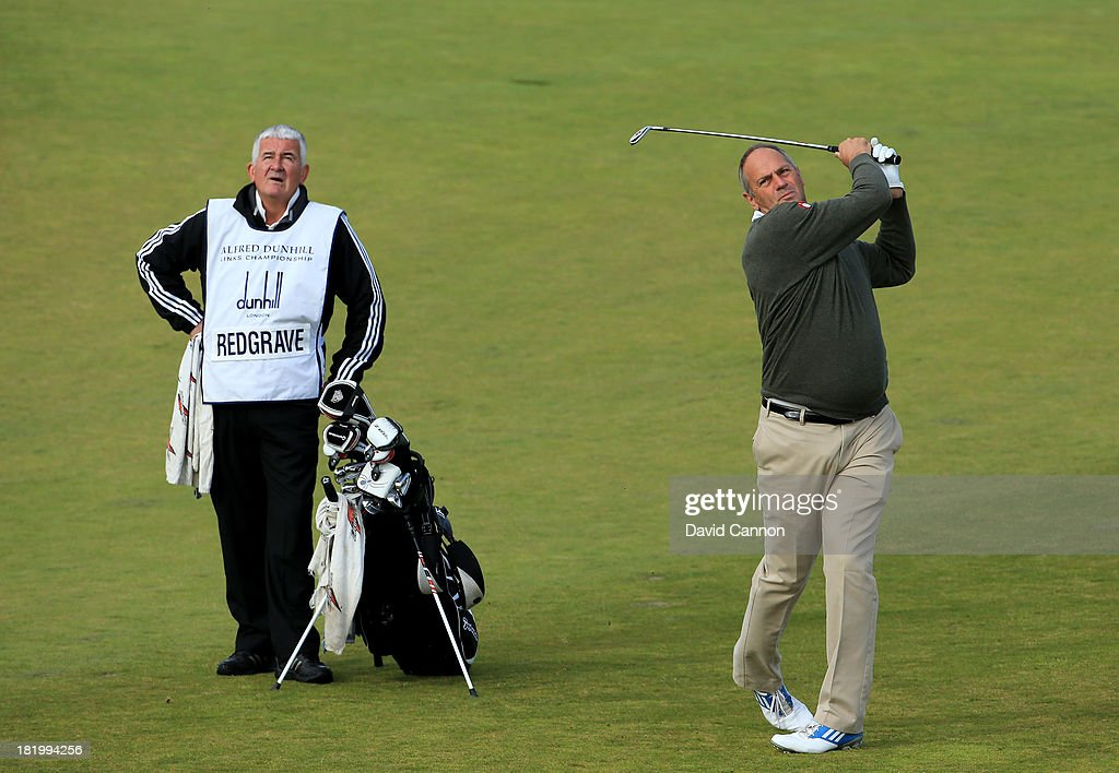 Sir Steve Redgrave of England the Olympic Gold Medal oarsman plays his second shot at the par 4, 10th hole during the second round of the 2013 Alfred Dunhill Links Championship at the Kingsbarns Golf Links on September 27, 2013 in Kingsbarns, Scotland.
