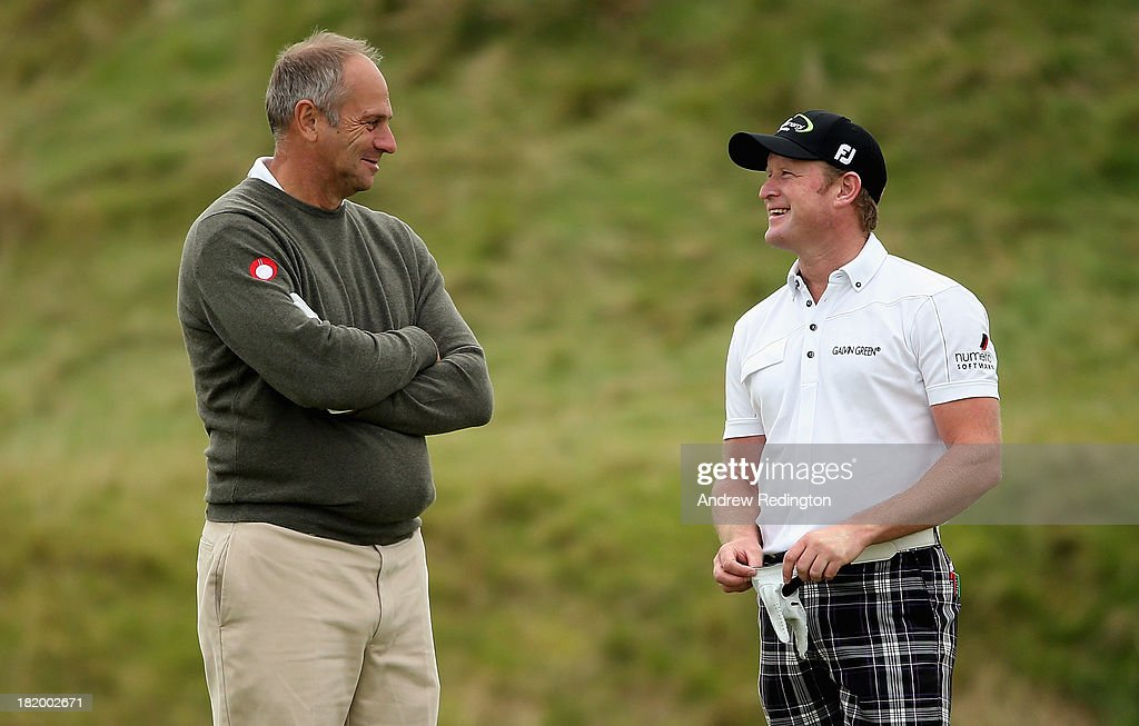 Sir Steve Redgrave, the former Olympic rower, (left) chats with Jamie Donaldson of Wales on the 16th hole during the second round of the Alfred Dunhill Links Championship at Kingsbarns Golf Links on September 27, 2013 in Kingsbarns, Scotland.