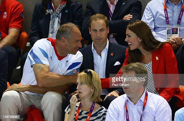 Sir Steve Redgraveshakes hands with Catherine Duchess of Cambridge during the swimming finals session on Day 7 of the London 2012 Olympic Games at...