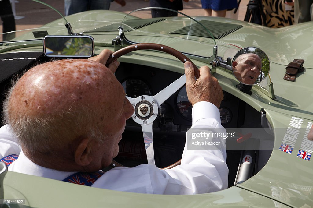 Sir Stirling Moss with the car he drove in the Monaco Grand Prix in 1954 at the Cartier 'Travel With Style' Concours 2013 at Taj Lands End on February 10, 2013 in Mumbai, India.