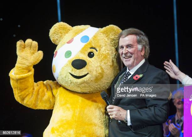 Sir Terry Wogan receives a cheque on behalf of Children In Need during Charlie and The Chocolate Factory's Children in Need Gala at the Theatre Royal...