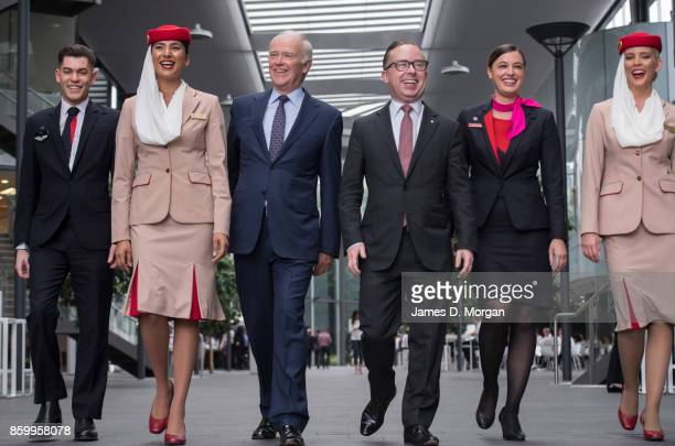 Sir Tim Clark President of Emirates Airline and Alan Joyce Qantas Group CEO at Qantas headquarters with two cabin crew from each airline on October...