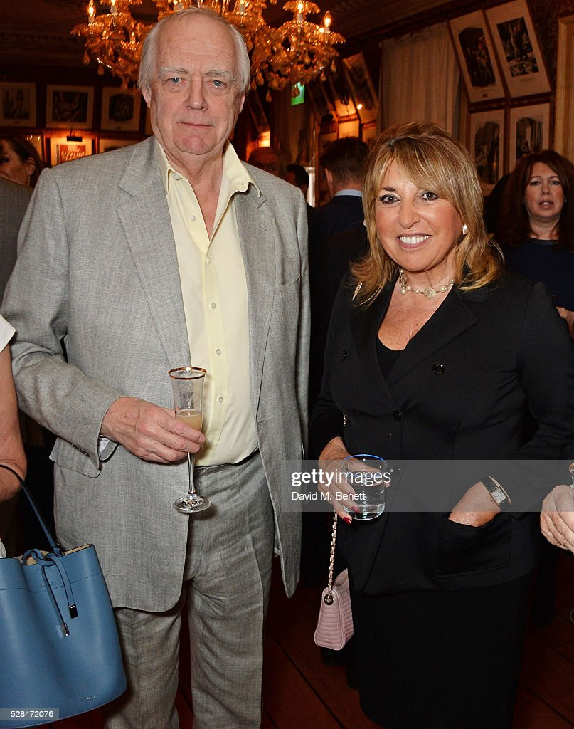 Sir Tim Rice (L) and Eve Pollard attend the launch of Dame Joan Collins' new book 'The St. Tropez Lonely Hearts Club' at Harry's Bar on May 5, 2016 in London, England.