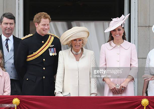 Sir Timothy Laurence as Prince Harry jokes with Camilla Duchess of Cornwall and Catherine Duchess of Cambridge as they stand on the balcony at...
