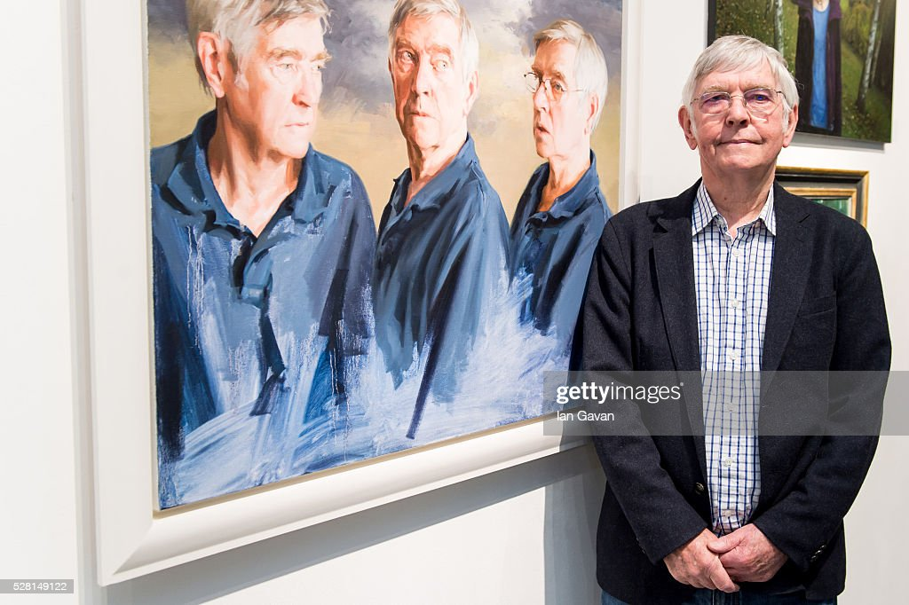 Sir <a gi-track='captionPersonalityLinkClicked' href=/galleries/search?phrase=Tom+Courtenay&family=editorial&specificpeople=699230 ng-click='$event.stopPropagation()'>Tom Courtenay</a> stands next to his portrait at the Royal Society of Portrait Painters Photocall at the Mall Galleries on May 4, 2016 in London, England.