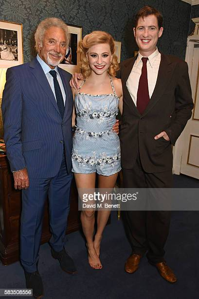 Sir Tom Jones poses backstage with cast members Pixie Lott and Matt Barber at the West End production of 'Breakfast At Tiffany's' at the Theatre...
