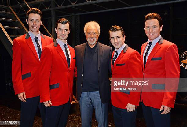 Sir Tom Jones poses with cast members Matt Nalton Edd Post Michael Watson and Jon Boydon backstage at the West End production of 'Jersey Boys' at the...