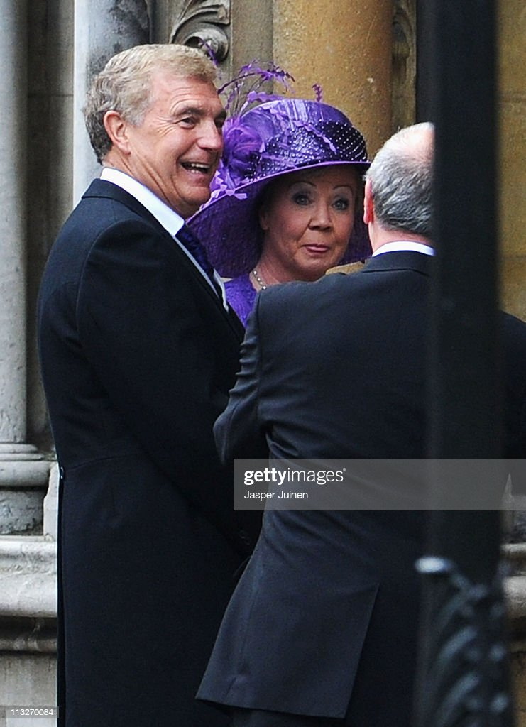 Sir Trevor Brooking walks (L) as Prince William and Princess Catherine make the journey by carriage procession to Buckingham Palace following their marriage at Westminster Abbey on April 29, 2011 in London, England. The marriage of the second in line to the British throne was led by the Archbishop of Canterbury and was attended by 1900 guests, including foreign Royal family members and heads of state. Thousands of well-wishers from around the world have also flocked to London to witness the spectacle and pageantry of the Royal Wedding.