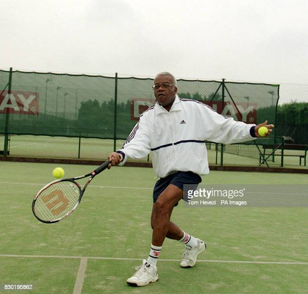 Sir Trevor McDonald plays tennis at the David Lloyd Sport Centre after receiving his knight hood earlier in the morning
