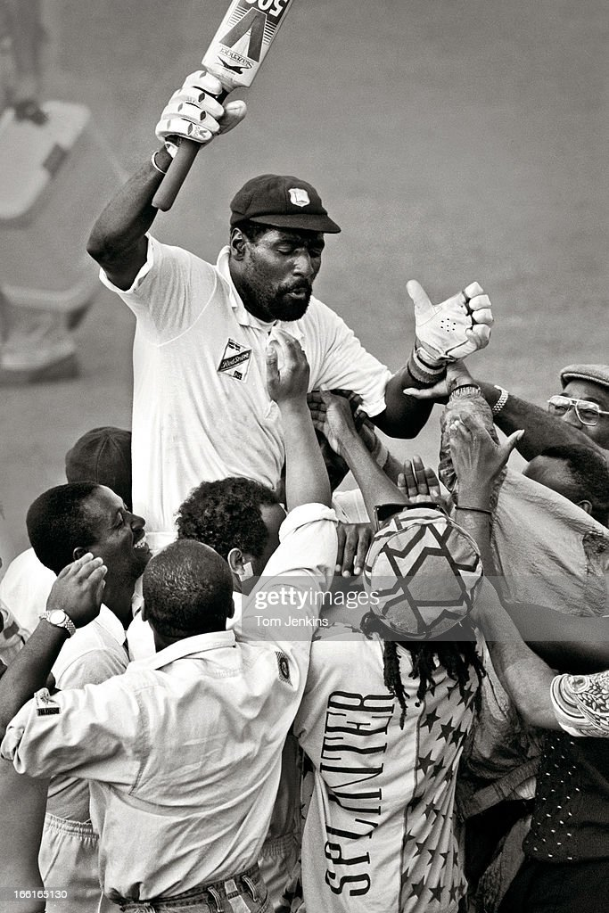 Sir Vivian Richards, the West Indian cricketer, is chaired off the pitch by celebrating fans after he helped secure victory over England in the 4th Test Match at the Edgbaston cricket ground, Birmingham on July 25th 1991 (Photo by Tom Jenkins/Getty Images). An image from the book 'In The Moment' published June 2012