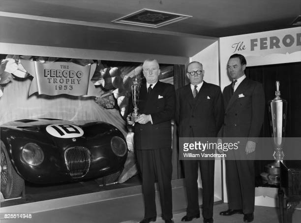 Sir William Lyons chairman of Jaguar Cars Ltd receives the Ferodo Trophy for outstanding British contribution to the sport of motor car racing in...