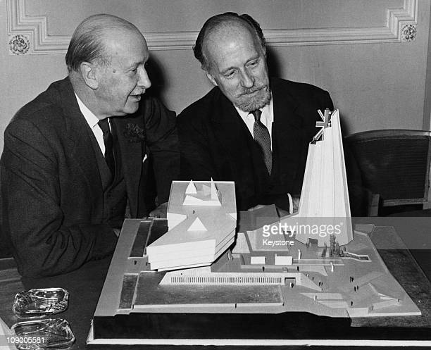 Sir William Oliver UK Commissioner General for Expo 67 in Montreal examining a model of the British pavillion with architect Basil Spence at a press...