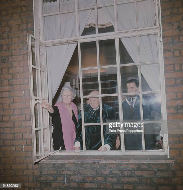 Sir Winston Churchill appears with his wife Clementine Churchill at an open window of their London residence at 28 Hyde Park Gate to mark the...