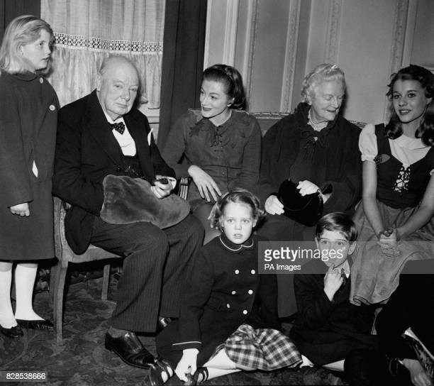 Sir Winston Churchill Lady Churchill and a family party after attending a performance of Peter Pan in which the Churchill's actress daughter Sarah...