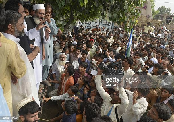 Siraj ul Haq leader of JamaateIslami' party speaks in Hussain Khanwala village some 55 kms southwest of Lahore on August 9 after a massive child...