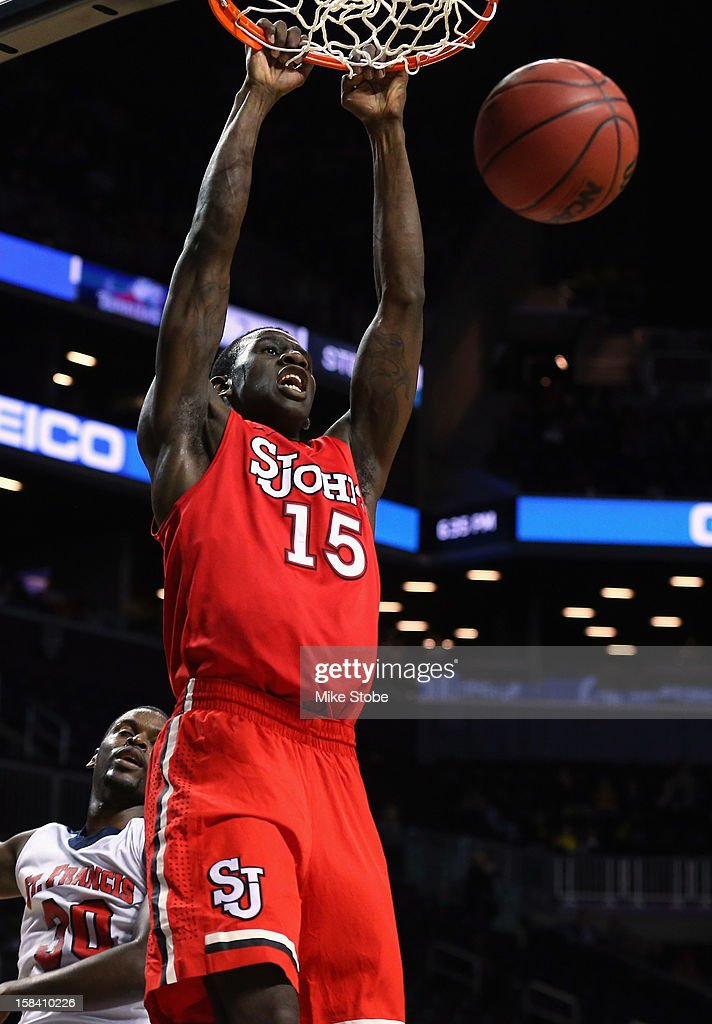 Sir'Dominic Pointer #15 of the St. John's Red Storm drives to the net for a basket against St. Francis Terriers during the Brooklyn Hoops Winter Festival on December 15, 2012 at Barclays Center in the Brooklyn borough of New York City. St. John's Red Storm defeated St. Francis (Ny) Terriers 77-60.