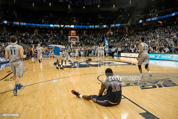 Sir'Dominic Pointer of the St John's Red Storm sits and watches the Creighton Bluejays celebrate after their game at CenturyLink Center January 28...