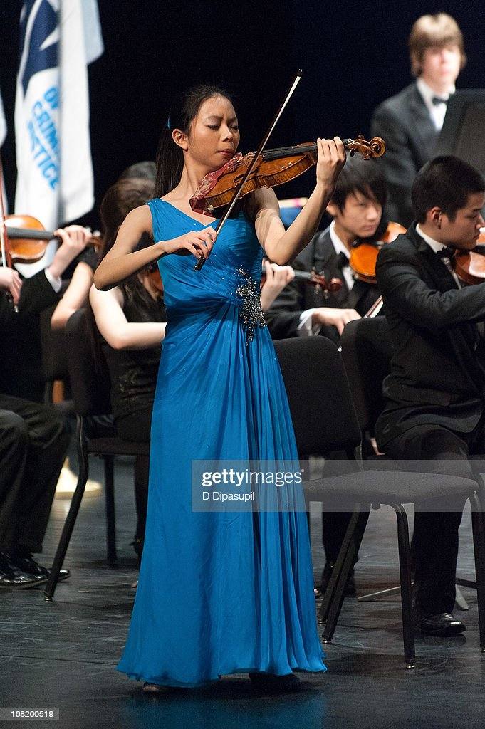 Sirena Huang performs on stage during the Newtown Memorial Concert at Gerald W. Lynch Theatre on May 6, 2013 in New York City.