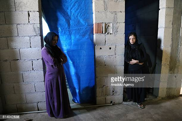 Siri Abufi and Fatma Abufi Syrian women who fled the civil war in their country are seen in their house in the Reyhanli district of Hatay Turkey on...