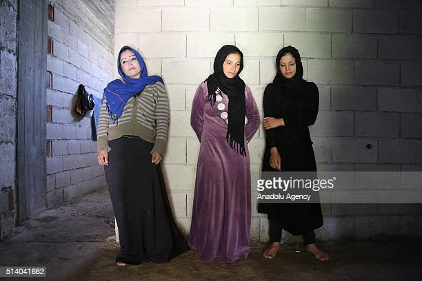 Siri Abufi Medlin Abu and Fatma Abufi Syrian women who fled the civil war in their country are seen in their house in the Reyhanli district of Hatay...