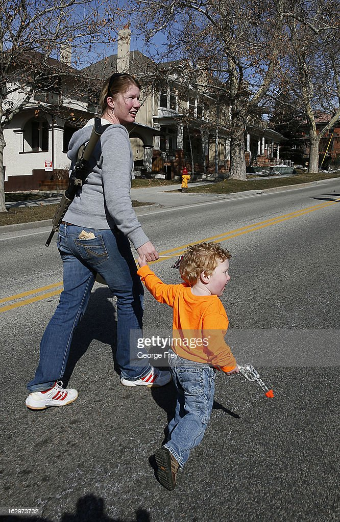 Siri Davidson, left and her son Keaton, walk up State Street with her AR-15 she got for Valentines Day to a gun rights rally at the Utah State Capitol on March 2, 2013 in Salt Lake City, Utah. The rally attracted several hundred people for the march to the Utah Capitol in favor of 2nd Amendment rights as gun control supporters call for more limits and bans on assault weapons.