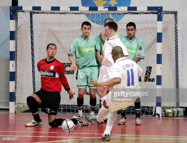 Sirilo of Dinamo Moscow competes against Rafa of Boomerang Interviu FS during UEFA Futsal Cup final on May 7 2006 in Moscow Russia