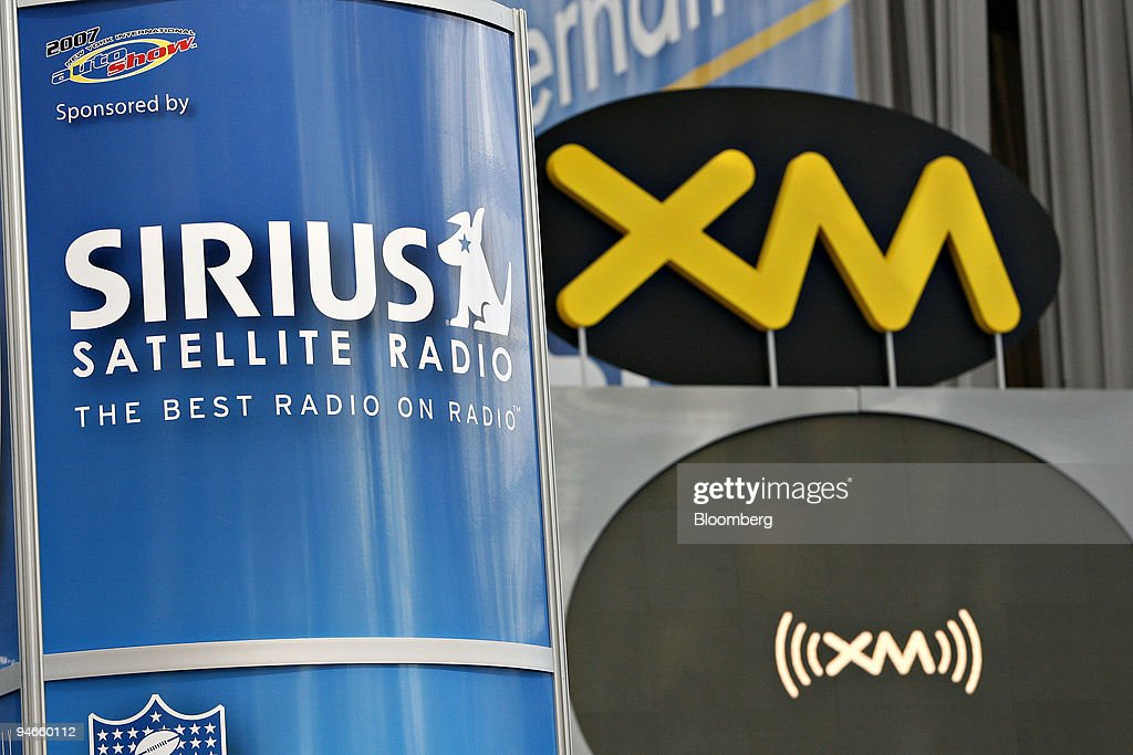 Sirius and XM satellite radio logos hang on display at the New York International Auto Show in New York Thursday April 5 2007 Since Sirius Satellite...
