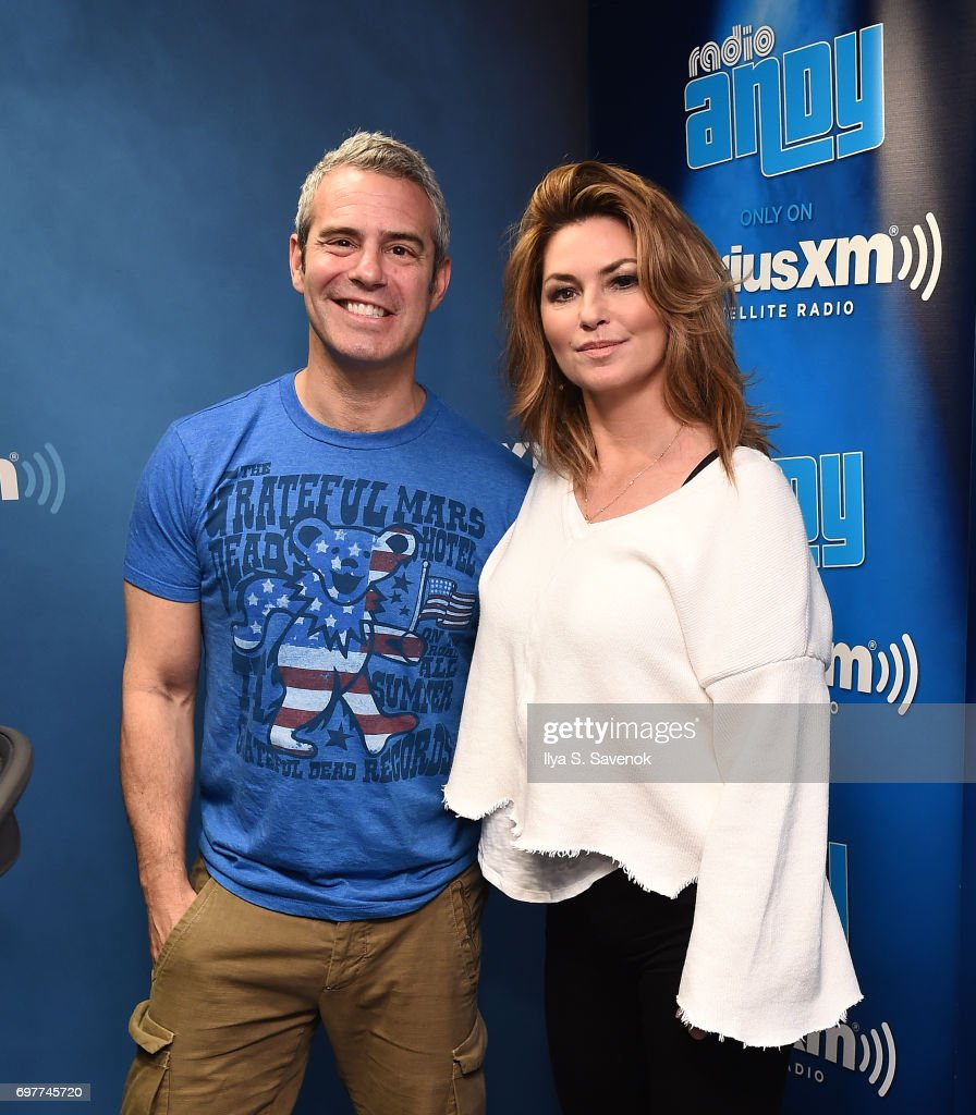 SiriusXM host Andy Cohen and singer Shania Twain pose for photos during a taping of 'Andy Cohen Live' on SiriusXM's Radio Andy at SiriusXM Studios on June 19, 2017 in New York City.