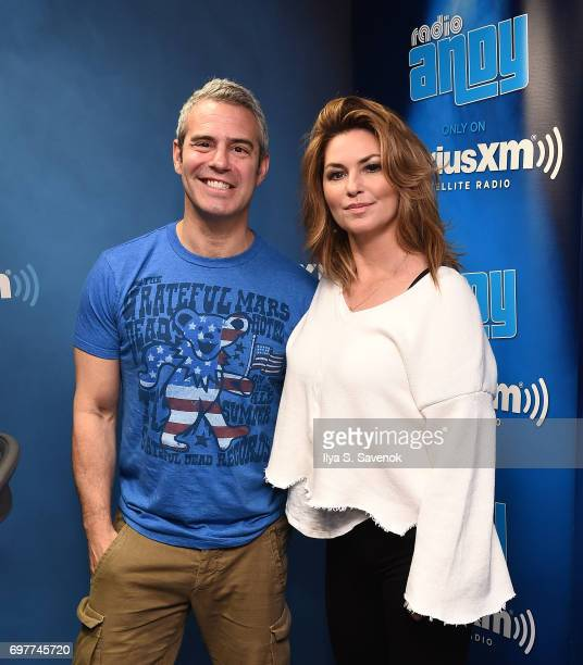 SiriusXM host Andy Cohen and singer Shania Twain pose for photos during a taping of 'Andy Cohen Live' on SiriusXM's Radio Andy at SiriusXM Studios on...
