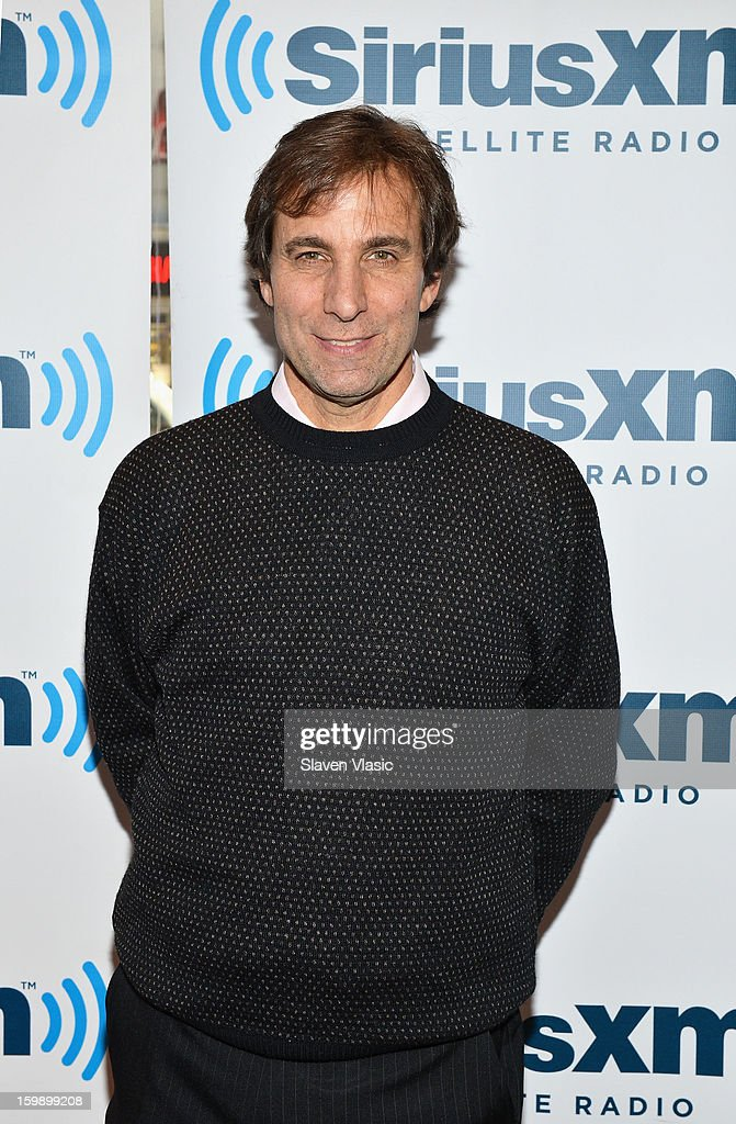 SiriusXM host Chris 'Mad Dog' Russo poses prior to a live broadcast on SiriusXM's 'Mad Dog Unleashed' at the NHL Powered by Reebok Store on January 22, 2013 in New York City.