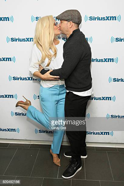 SiriusXM host Jenny McCarthy and husband Donnie Wahlberg pose for a photo at the SiriusXM Studio on April 11 2016 in New York City