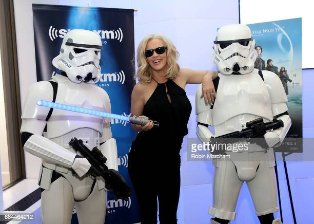 SiriusXM host Jenny McCarthy poses with Stormtroopers for BluRay release of Rouge One at SiriusXM Studios on April 4 2017 in New York City