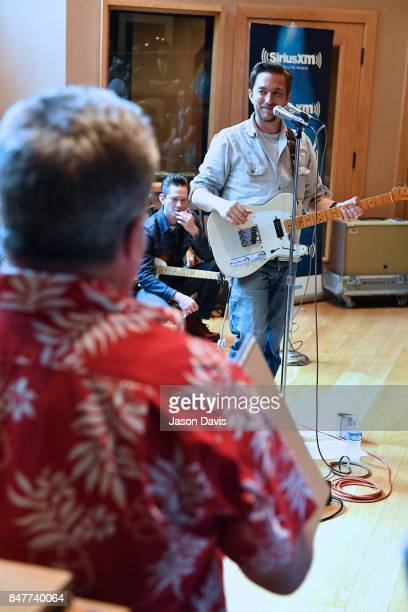 SiriusXM Host Mojo Nixon speaks to Recording Artist JD McPherson during his concert for SiriusXM Outlaw Country channel at Addiction Sound Studios on...
