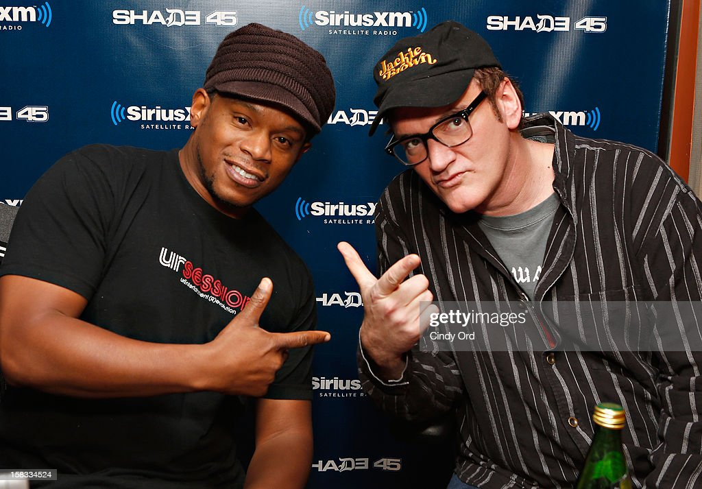SiriusXM host Sway Calloway poses with director Quentin Tarantino during his visit to 'Sway in the Morning' on Eminem's Shade 45 channel at the SiriusXM Studios on December 13, 2012 in New York City.