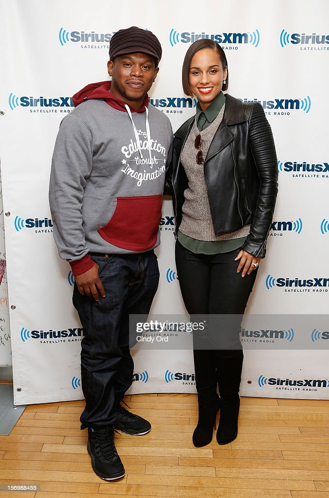 SiriusXM host <a gi-track='captionPersonalityLinkClicked' href=/galleries/search?phrase=Sway&family=editorial&specificpeople=214641 ng-click='$event.stopPropagation()'>Sway</a> Calloway poses with singer <a gi-track='captionPersonalityLinkClicked' href=/galleries/search?phrase=Alicia+Keys&family=editorial&specificpeople=169877 ng-click='$event.stopPropagation()'>Alicia Keys</a> prior to participating in the SiriusXM Town Hall With <a gi-track='captionPersonalityLinkClicked' href=/galleries/search?phrase=Alicia+Keys&family=editorial&specificpeople=169877 ng-click='$event.stopPropagation()'>Alicia Keys</a> And Moderator <a gi-track='captionPersonalityLinkClicked' href=/galleries/search?phrase=Sway&family=editorial&specificpeople=214641 ng-click='$event.stopPropagation()'>Sway</a> Calloway Live On 'Heart And Soul' at SiriusXM Studios on November 26, 2012 in New York City.