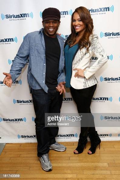 SiriusXM host Sway poses with TV personality Evelyn Lozada at SiriusXM Studios on September 24 2013 in New York City