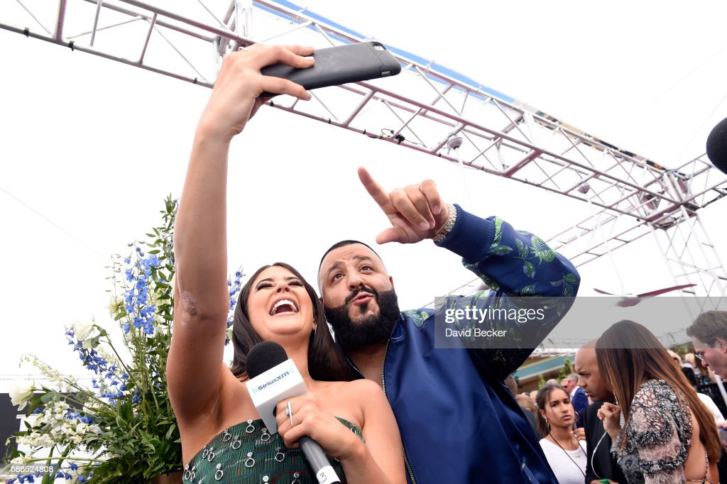 SiriusXM host Symon (L) and DJ Khaled pose at SiriusXM's 'Hits 1 in Hollywood' red carpet broadcast on SiriusXM's SiriusXM Hits 1 channel before theBillboard Music Awards at the T-Mobile Arena on May 21, 2017 in Las Vegas, Nevada.